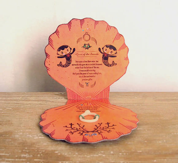 Handmade seashell Valentine with a cold porcelain ring tucked inside, via Misako Mimoko on Etsy