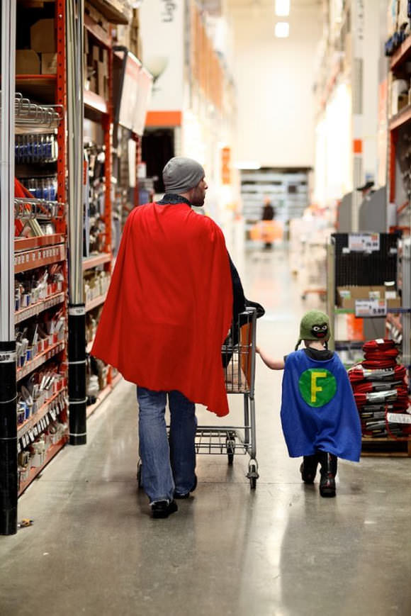 Father & son in matching superhero capes, browsing the aisles of Home Depot for supplies – best pic ever!