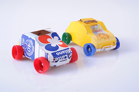 Diy recycling center for kids recycled juice cartons and plastic bottle caps make great toy cars solutioingenieria Images