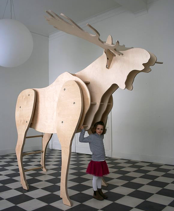 Father Moose, a 9ft tall moose with bookshelves and a place for kids to read, hide, and sleep.