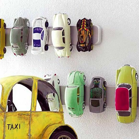 IKEA Hacks for Kids' Rooms: GRUNDTAL magnetic knife rack repurposed as a wall storage for toy cars