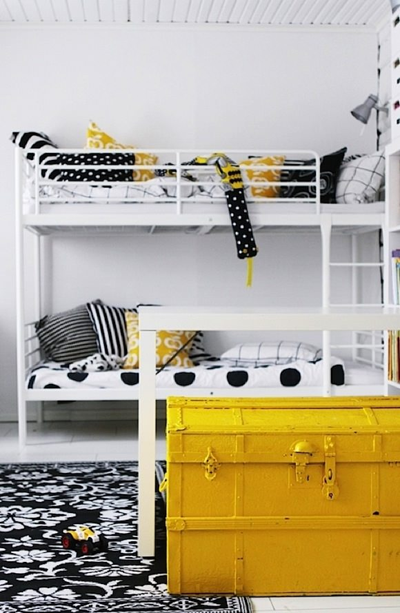yellow painted military trunk add a pop of color in a child's room