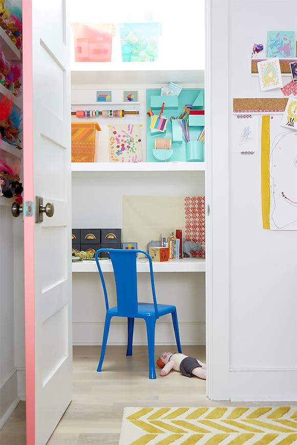 "a hidden closet ""office"" in a kid's room, stocked with craft supplies"