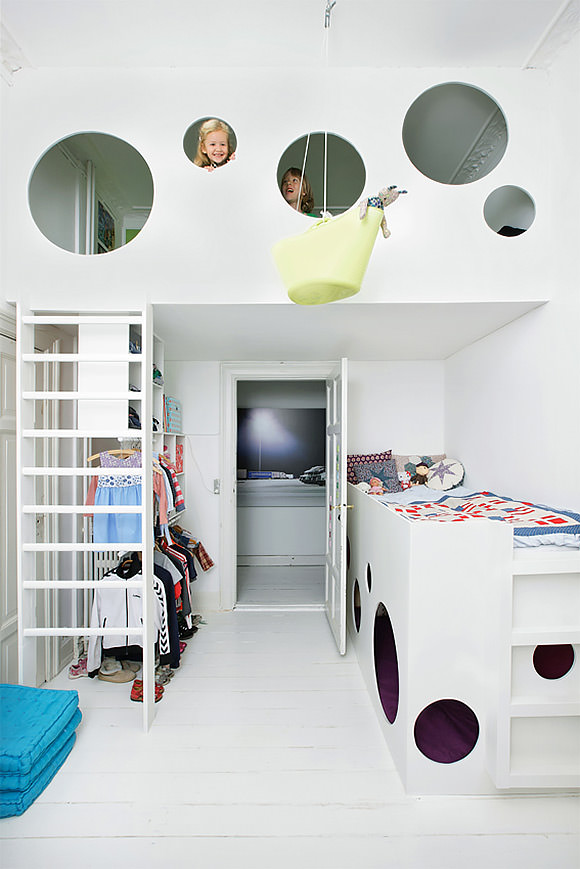 A suspended bunk bed in a kid's room cleverly designed for a small space