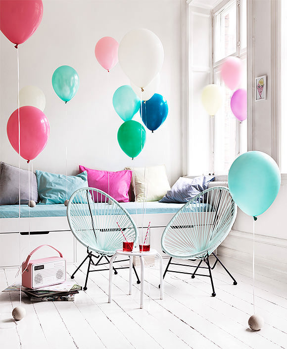 adding pops of color to a kid's room using balloons