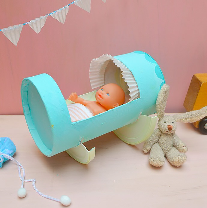 Recycled doll cradle craft for kids handmade charlotte for Handmade things from waste material for kids step by step