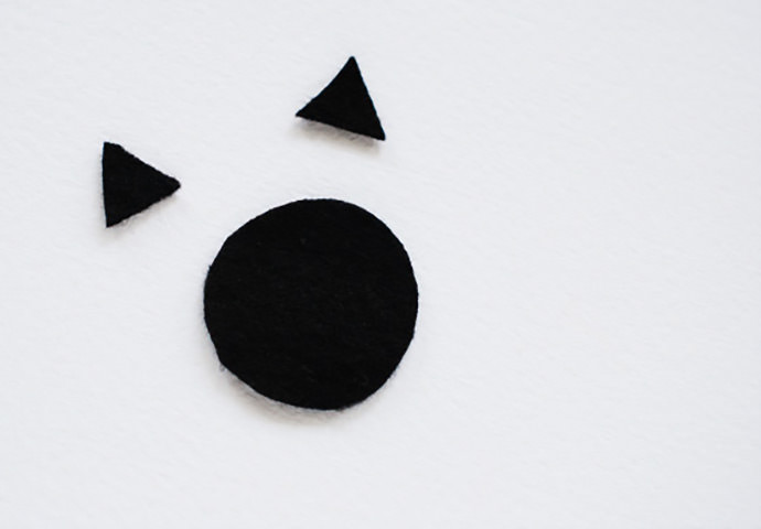 Create wooden critter ornaments with a wooden ball and black felt