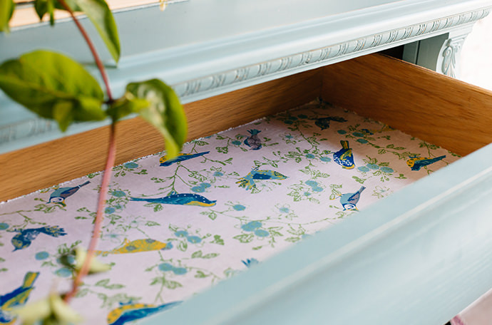 Drawer lined with Waverly botanical fabric